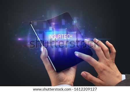 Businessman holding a foldable smartphone, new technology concep Stock photo © ra2studio