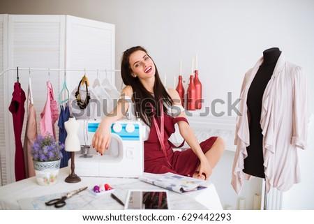 женщину швейных ткань швейные машины домой дизайнера Сток-фото © robuart