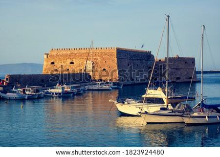 Venetian Fort in Heraklion and moored fishing boats, Crete Island, Greece Stock photo © dmitry_rukhlenko