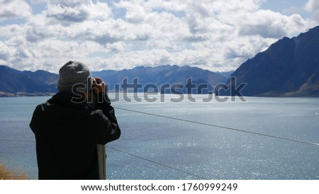 New Zealand tourists taking phone pictures of Wanaka Lone Tree at lake. People looking at view of fa Stock photo © Maridav
