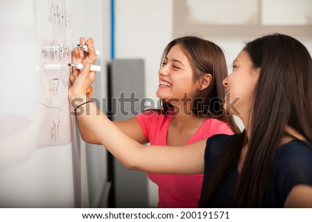 High School students. Pretty female student laughing while mixin Stock photo © HASLOO