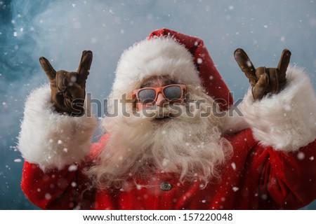 santa claus wearing sunglasses dancing outdoors at north pole stock photo © hasloo
