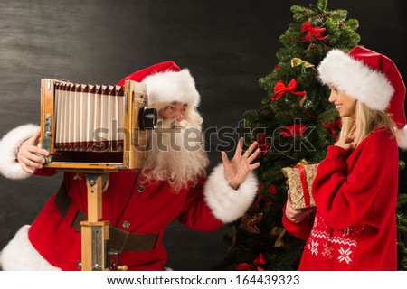 Photo of Santa Claus with his wife surprising and opening Christ Stock photo © HASLOO