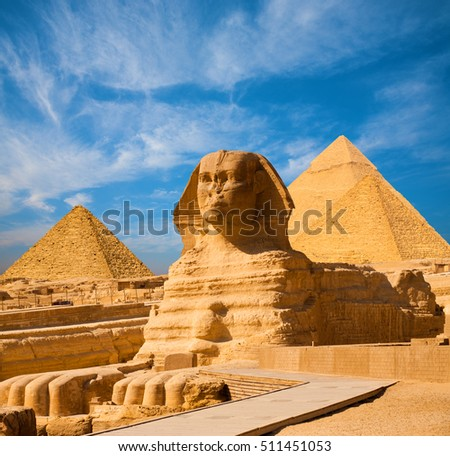 Stock photo:  full profile of the Great Sphinx with the pyramid in the backgr