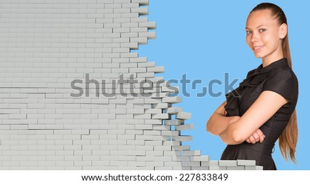 Businesswoman smiling and looking at camera. Dilapidated brick wall, green meadow with sky as backdr Stock photo © cherezoff