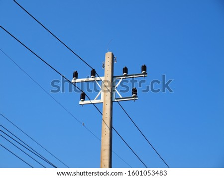 electricity poles with wires and green glass insulators against deep blue sky stock photo © rekemp