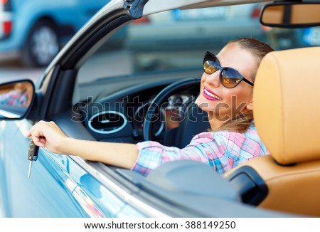 young pretty woman in sunglasses sitting in a convertible car wi stock photo © vlad_star