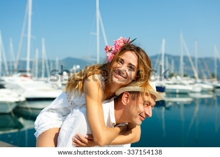 Attractive young couple have fun in the marina with moored boats Stock photo © vlad_star