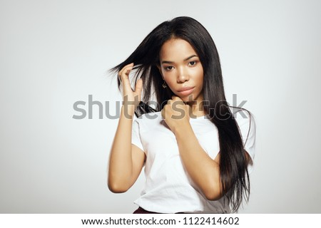 happy attractive woman with beautiful long dark hair in motion stock photo © deandrobot