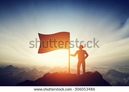 Proud man raising a flag on the peak of the mountain. Challenge, achievement Stock photo © photocreo