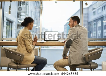 business people creating presentation and using laptop together in office stock photo © deandrobot