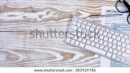 Faded white desktop with tax form and pen with reading glasses Stock photo © tab62