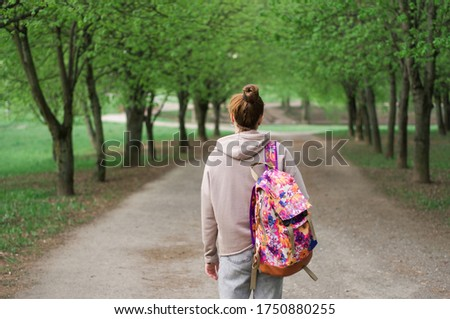 Teenagers with backpacks and books walking outside at the campus Stock photo © deandrobot