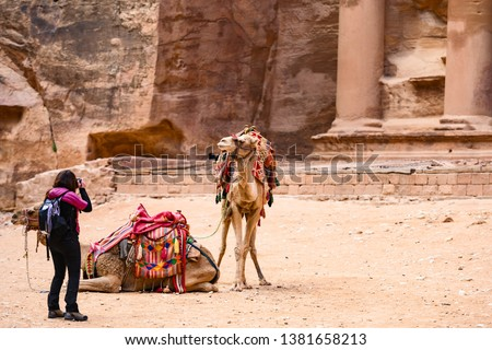Tourist taking a photo of old  historical building (Petra, Jordan) stock photo © zurijeta