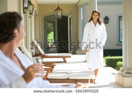 Man with a glass in her hand sitting in the chair by the firepla Stock photo © UrchenkoJulia