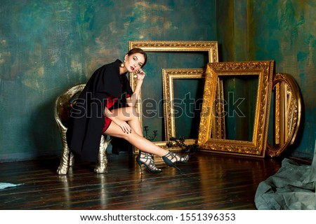 beauty rich brunette woman in luxury interior near empty frames, Stock photo © iordani