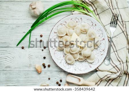 meat dumplings   russian pelmeni with sour cream on rustic backg stock photo © yatsenko