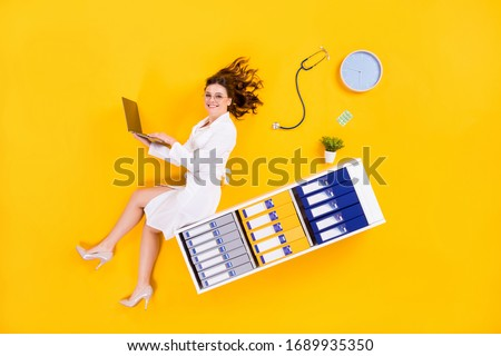 side view of professional doctor in white coat sitting on table in cabinet Stock photo © LightFieldStudios