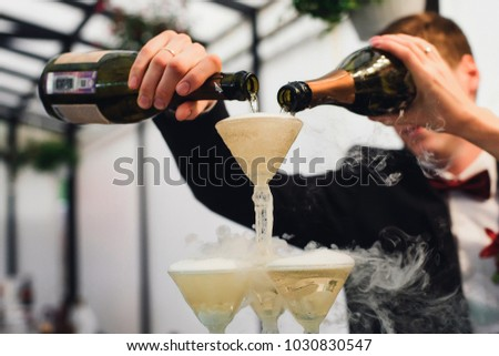 Bottle pour Glass of champagne tower. Alcohol in glass belfry. W Stock photo © MaryValery