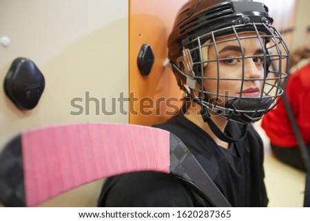 Portrait of female athlete wearing helmet while playing rugby Stock photo © wavebreak_media