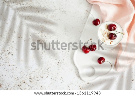 Fresh cherry yogurt with oats and chia seeds, delicious dessert for healthy breakfast Stock photo © yelenayemchuk