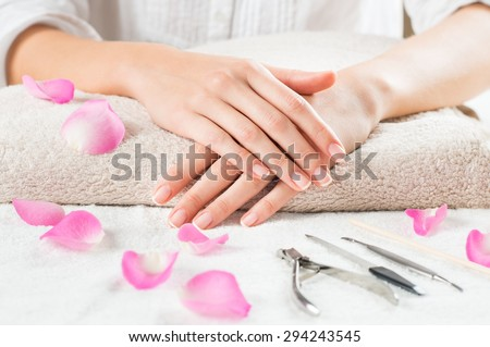 closeup shot of beautiful female hands fingers with french mani stock photo © nobilior