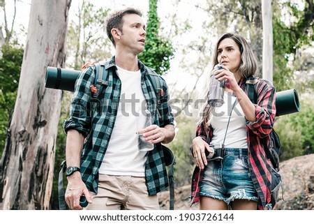 Andarilho casal em pé floresta juntos Foto stock © wavebreak_media