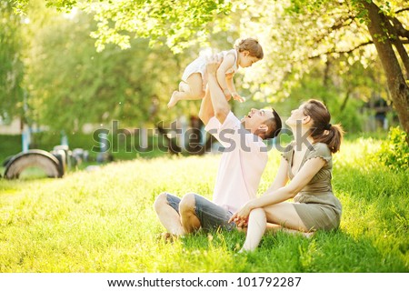 happy young family spending time outdoor on a summer day picnic stock photo © yatsenko