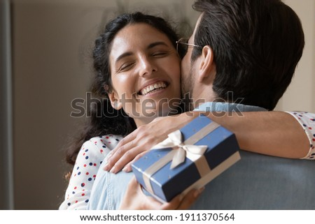 Girl taking beloved boyfriend by surprise on date, closing his eyes from behind Stock photo © motortion