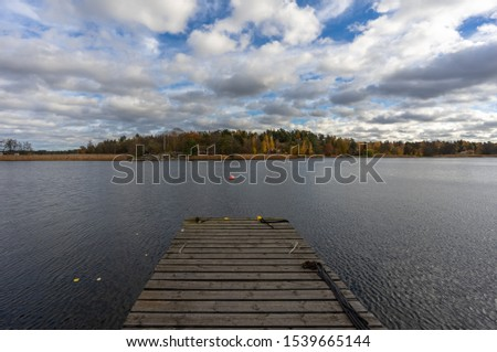 Wooden dock at a rocky shore with pine trees at a Nordic lake Stock photo © Mps197