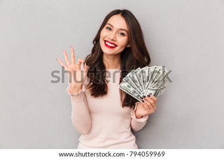 trésorerie · gagnant · joli · femme · argent · isolé - photo stock © deandrobot