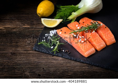 Salmon filet sliced on part with lime, salt, pepper, rucoli,fennel and rosemary, ready to cook. Stock photo © FreeProd