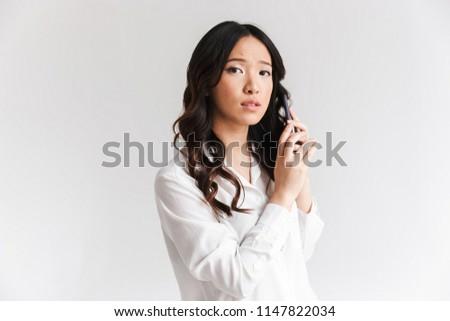Fotografia poważny chińczyk kobieta długo ciemne włosy Zdjęcia stock © deandrobot
