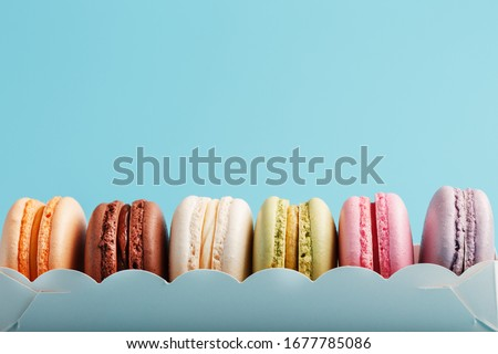 Dessert cake macaron or macaroon in white wooden box on stone kitchen table background . Top view.  Stock photo © DenisMArt