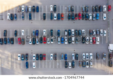 Aerial view of many empty parking spaces with markings summer day . Top view Stock photo © artjazz