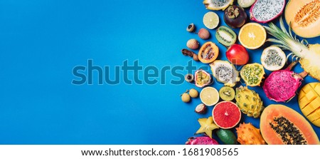 Lychee fruit and pitahaya on a blue background with copy space for text. Flat lay Stock photo © artjazz