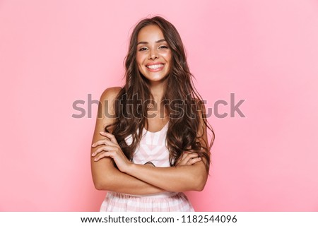 Image of beautiful woman 20s with long hair wearing dress smilin Stock photo © deandrobot