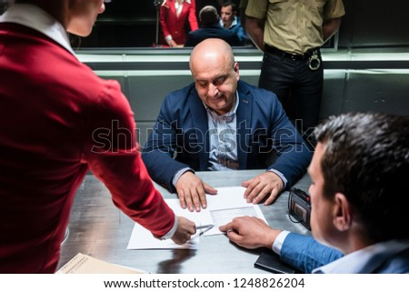 defendant or witness counseled by the lawyer to sign an official statement stock photo © kzenon