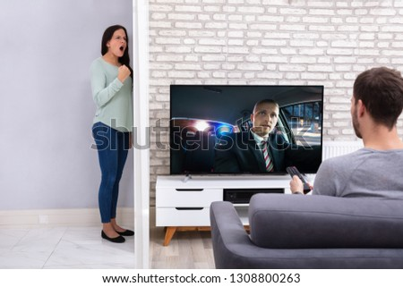 Angry Woman With Neighbor Man Watching Television Loud At Home Stock photo © AndreyPopov