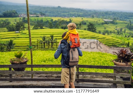 Boy traveler on Beautiful Jatiluwih Rice Terraces against the background of famous volcanoes in Bali Stock photo © galitskaya