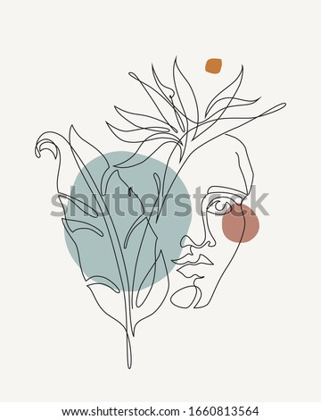 Exotic strelitzia flower in a woman's hand with tattoo on a green background, copy space. Postcard f Stock photo © artjazz