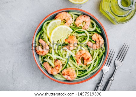 Healthy fresh vegetable salad with shrimp and spaghetti, onion rings and lemon in black bowl top ang Stock photo © makyzz