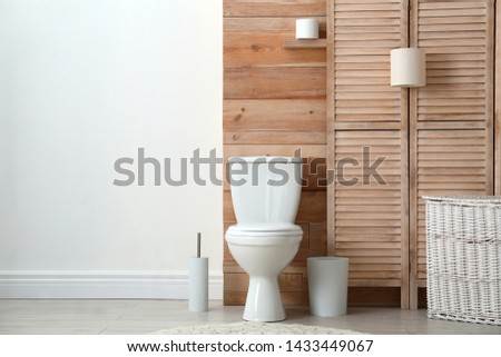 Bathroom interior with toilet bowl and toilet paper. Flat vector illustration. Stock photo © makyzz