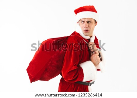 portrait of displeased man 30s in santa claus costume and red ha stock photo © deandrobot