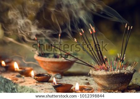 burning aromatic incense sticks incense for praying buddha or hindu gods to show respect stock photo © galitskaya