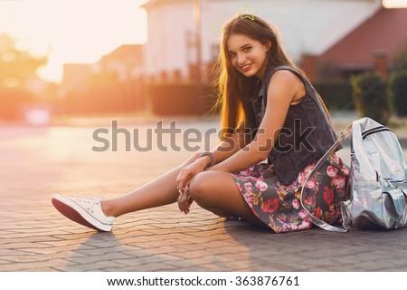 Summer lifestyle portrait of pretty girl sitting on the orange inflatable sofa on the beach of tropi Stock photo © galitskaya