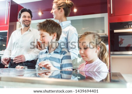 children checking out the new kitchen their parents are about to buy stock photo © kzenon