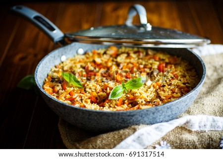 Pilaf with beef, carrots, onions, garlic, pepper and cumin. A traditional dish of Asian cuisine. Sel Stock photo © galitskaya