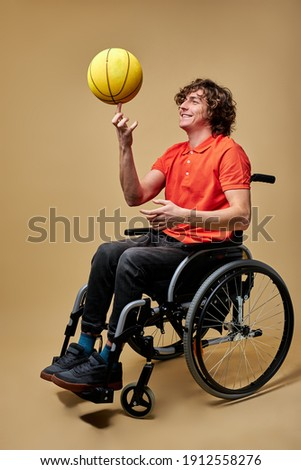 Sportsman sitting on wheelchair by medical equipment while doctor pointing at it Stock photo © pressmaster