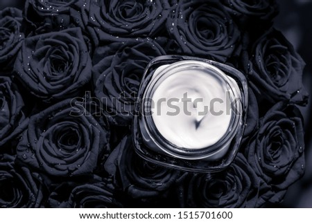 Face cream skin moisturizer and black roses flowers, luxury skin Stock photo © Anneleven
